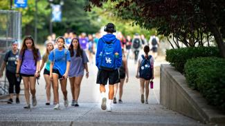Groups of students walking through campus.